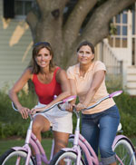 Two women on bicycles.